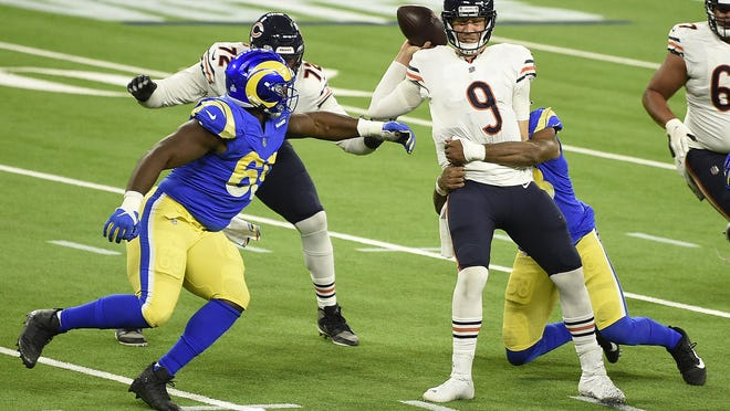 Chicago Bears quarterback Nick Foles (9) is sacked by Los Angeles Rams linebacker Justin Hollins during the second half of an NFL football game Monday, Oct. 26, 2020, in Inglewood, Calif.