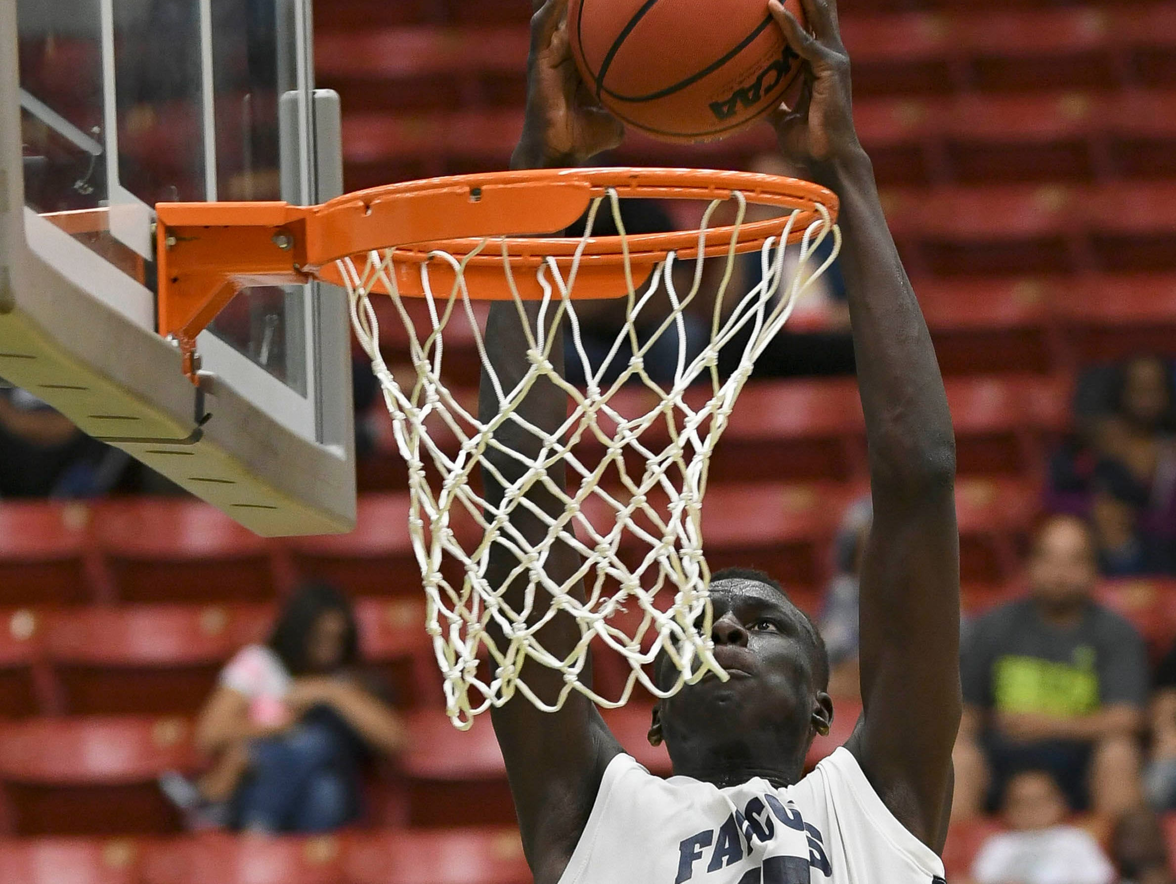 Mbacke Diong of Florida Prep dunks the ball during Wednesday's Class 2A basketball final.