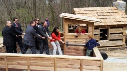 BB&T officials and Devou Good Project President Rebekah Gensler Butler pull a replica of a flatboat with the help of two young captains at NaturePlay@BCM.