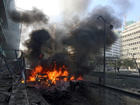 Flames blaze from vehicles at the scene of an explosion in Beirut, Lebanon, Friday.
