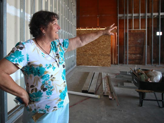 Galilee Foundation co-founder Gloria Gomez stands in the future community center adjacent to showers and a rest area for migrant farmworkers. The foundation of a community center is underway, but an additional $100,000 is needed for the center's completion.