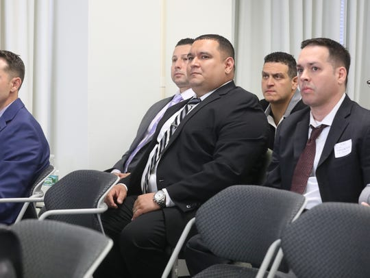 Left to right are former members of the Hackensack