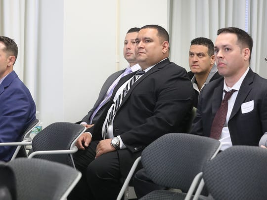 Left to right are former members of the Hackensack Police  Department, Detective Joseph Gonzalez, Detective Rocco Duardo, Officer Victor Vazquez. Behind Vasquez is police union President Frank Cavallo, in court to show support for the five police officers including Detective Mark Guitterez and Sgt Justin de la Bruyere.