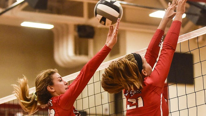 Harding's Whitney Starner, left, and Abbi Jackson attempt a block during a Mid Ohio Athletic Conference volleyball match against River Valley last season. Both Prexies are back to anchor the front line.
