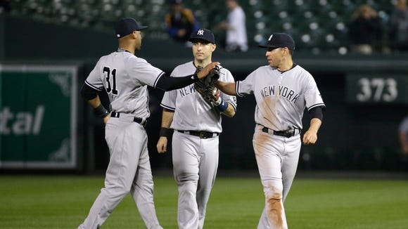 New York Yankees outfielders Aaron Hicks, from left,