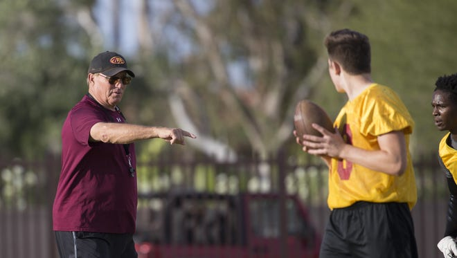 Mountain Pointe's head coach Norris Vaughan instructs his team during a practice at Mountain Pointe High School on April 29, 2016 in Phoenix, Ariz.