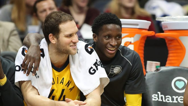 Dec 20, 2017; Atlanta, GA, USA; Indiana Pacers guard Victor Oladipo (4, right) talks with forward Bojan Bogdanovic (44) on the bench during the fourth quarter against the Atlanta Hawks at Philips Arena. Mandatory Credit: Jason Getz-USA TODAY Sports