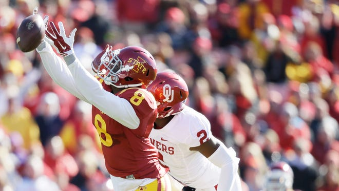 Oklahoma cornerback Julian Wilson, right, breaks up a pass intended for Iowa State wide receiver D'Vario Montgomery (8) during the first half.