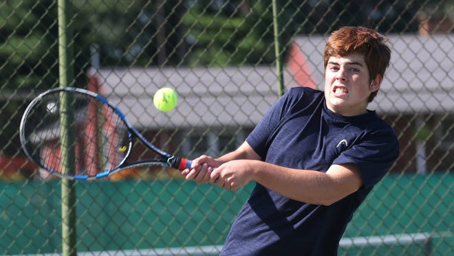 Ryan Mecurio returns a backhand in his 6-3, 6-0 win over Tommy Secrist in the boys 16 final of the 85th News Journal/Richland Bank Tennis Tournament at Lakewood Racquet Club.