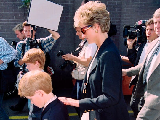 Britain's Princess Diana  and her son Harry arrive