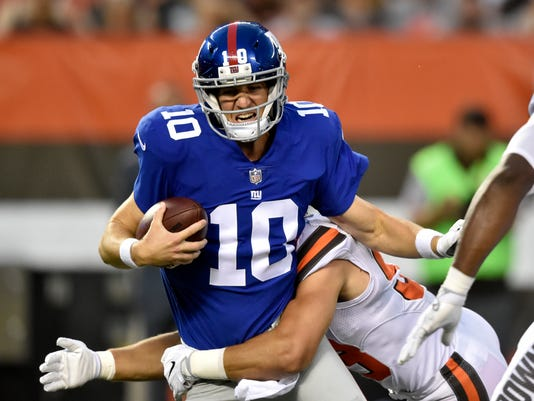 New York Giants quarterback Eli Manning (10) is sacked by Cleveland Browns outside linebacker Joe Schobert (53) in the first half of an NFL preseason football game, Monday, Aug. 21, 2017, in Cleveland. (AP Photo/David Richard)