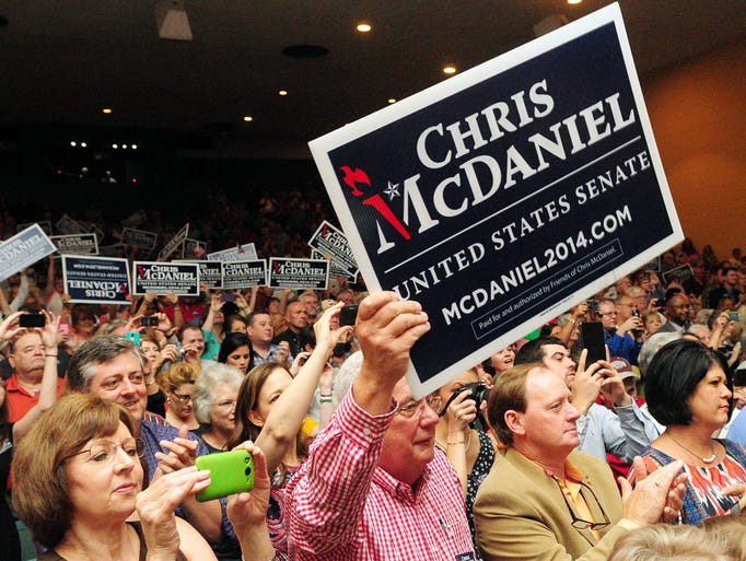 Spectators show their support as U.S. Senate candidate Chris McDaniel walks on stage Friday at the Jones County Junior College Fine Arts Center in Ellisville during a campaign rally.