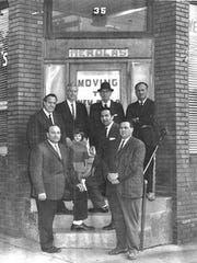 The Merola family in front of their store