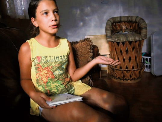 Sarah Montejano, 9, talks about her drawings in her Central El Paso home. Montejano has experienced relief from epileptic seizures with help from certain medications.