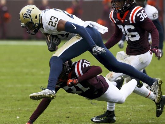 Pittsburgh wide receiver Tyler Boyd (23) leaps for yardage past Virginia Tech defender Brandon Facyson (31).