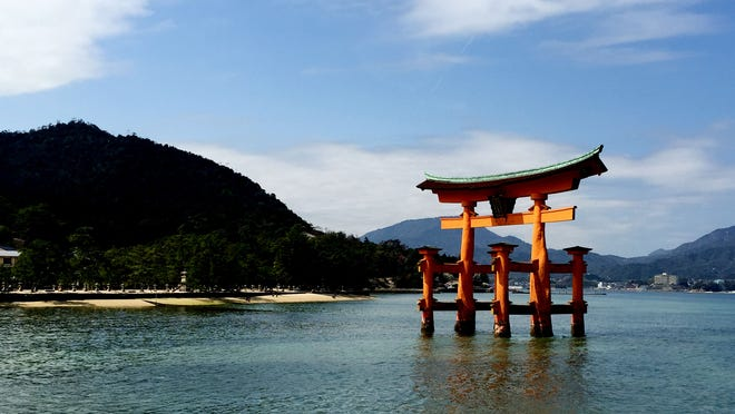 The great Torii of the Shinto shrine, Itsukushima, greets visitors to Miyajima, an island near Hiroshima, Japan. First built in 1168, the gate is 16 1/2 meters high and weighs about 60 tons. The gate that stands today was built in 1875 and is the eighth O-Torii (grand gate).