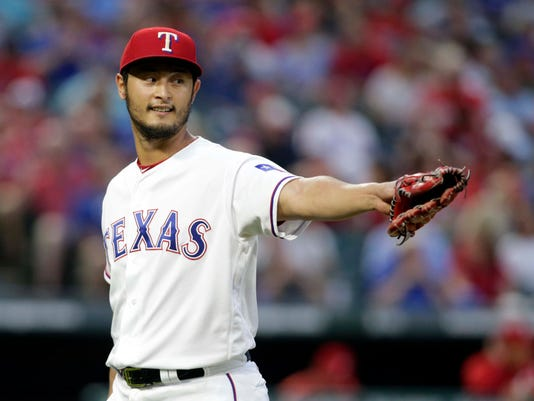 fdde40f92 Yu Darvish pitches Rangers to seventh consecutive victory