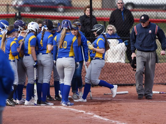 Maysville waits to engulf Rylie Miller as she approaches the plate after hitting a grand slam against Crooksville on Monday.