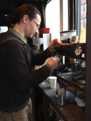 Jason Gonzalez, manager of Blue Bird Coffee Stop, makes