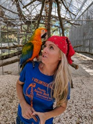 Zsa Zsa, an 8-year-old Catalina Macaw, poses with Stephanie