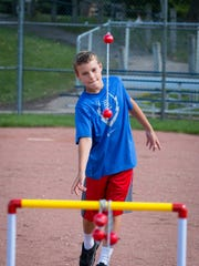 12 year old Eric Detienne launches the bolo at the ladder toss game set up at the annual Bayside Village Picnic events Sept. 10. Childrens activities, live music, and great food filled Ellsworth Park under great weather.