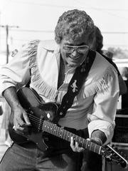 "Fleet-fingered Carl Perkins plays a solo on ""I'll Fly Away at Fan Fair June 10, 1986. The superstar was a surprise guest with fellow ""Memphis Homecoming"" artist Johnny Cash and Jerry Lee Lewis at the Mercury/PolyGram Records show at the Fairgrounds."