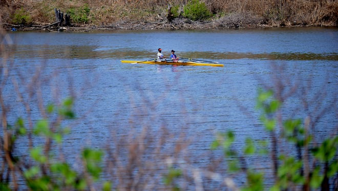 Overpeck park on an unseasonably warm day in Leonia. The temperature hit 91 degrees on Thursday May 03, 2018. Two people row along Overpeck Creek during the warm weather.
