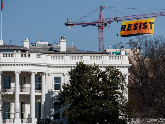 BESTPIX - Protesters Climb Atop A Crane In Washington, D.C.