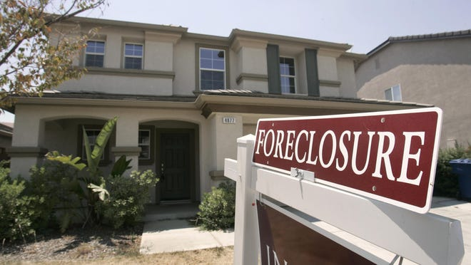 A foreclosed home is seen for sale.