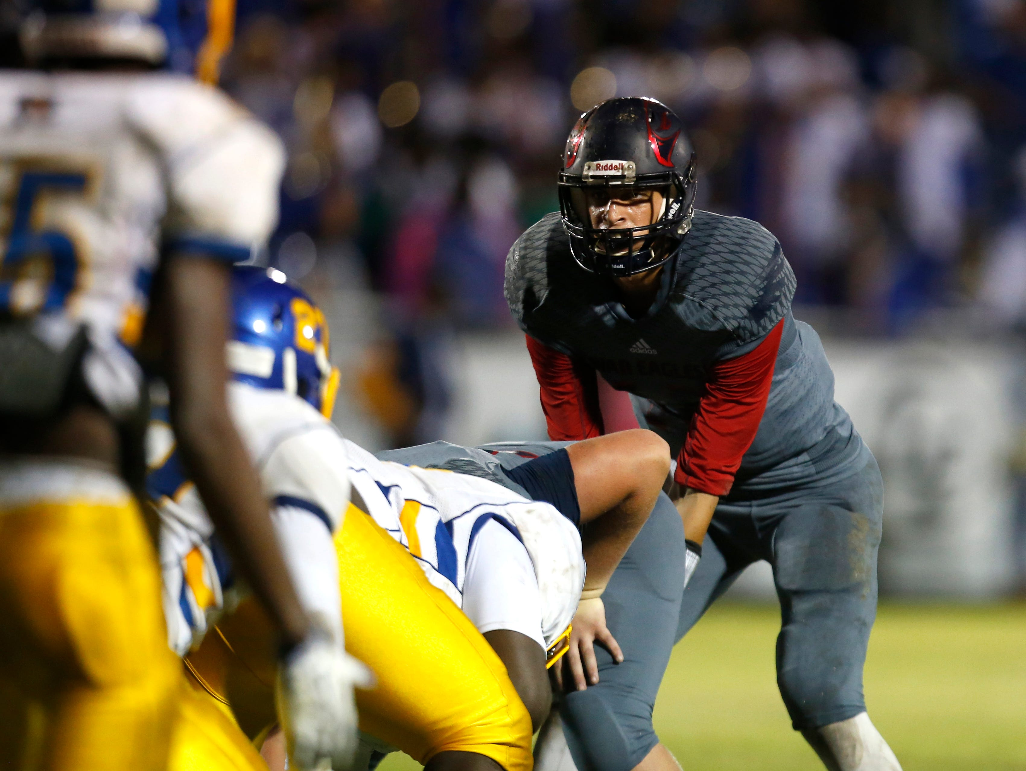 Wakulla's Feleipe Franks gets set to hike the ball against Rickards during their playoff game on Friday