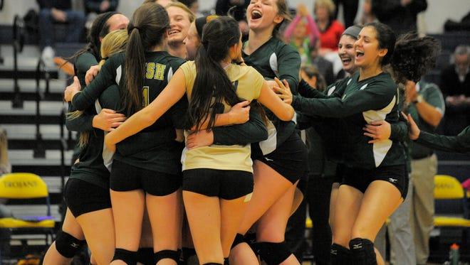 Pontiac Notre Dame Prep celebrates their win over Dearborn Divine Child, Tuesday Nov. 18, 2014, during volleyball quarterfinals at Clawson High School in Clawson.