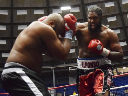 Robert Alfonso and Ronnie Hale face off in a boxing