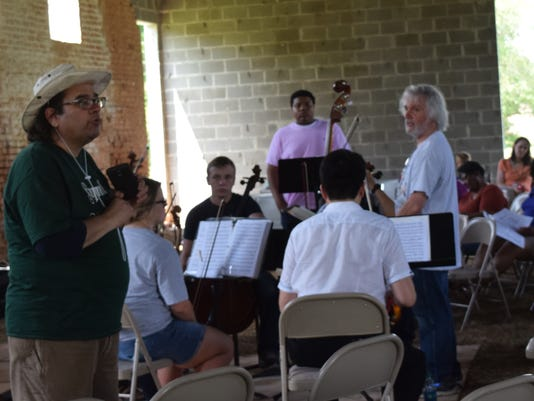 Thomas Harmeyer (left), organizer of the Sugarmill Music Festival, talks to the audience prior to the performance of the Young Artists Chamber Orchestra under the direction of John De Chiaro, former orchestra director for Rapides Parish Schools. The Sugarmill Music Festival held over the weekend at the old Sugarmill on Rosalie Plantation. The Sugar Music Festival was produced by CreativeSurge Louisiana.