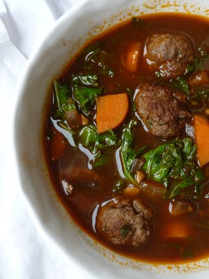Lamb meatball stew with Russian kale chases away the winter blues.