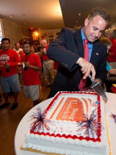Escambia County Commission District 2 candidate Doug Underhill cuts a victory cake for his supporters at 511 on Palafox Street Tuesday night. Underhill defeated incumbent candidate Gene Valentino by a wide margin.