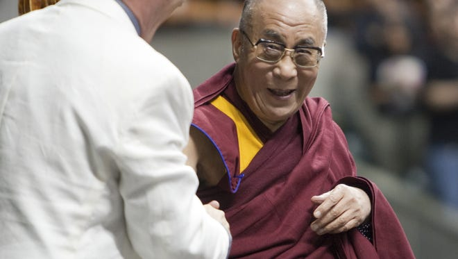 His Holiness, the 14th Dalai Lama of Tibet, greets cellist Michael Fitzpatrick after he played an introduction at Conseco Fieldhouse, Indianapolis, IN, Friday, May 14th, 2010.