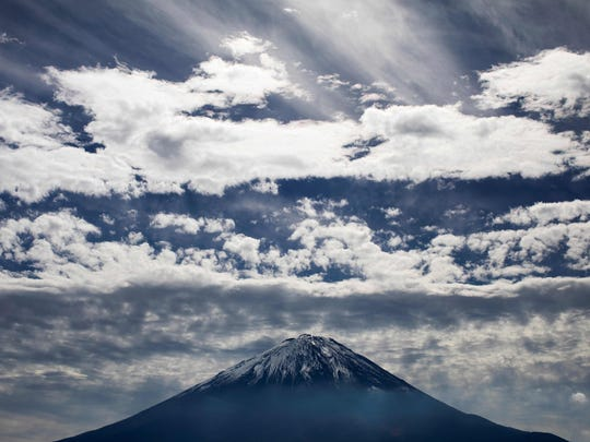 Mount Fuji is the tallest in Japan and an active volcano.