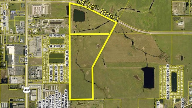 The larger of the two tracts being auctioned Saturday, the 101.5 acres called the Coker Cattle Parcel south of Southeast 28th Street and east of U.S. 441, is closer to being ready for development. The land currently is owned by the Okeechobee Utility Authority.
