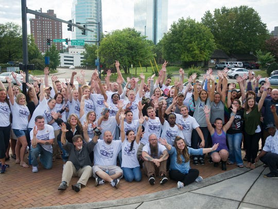 Recovering addicts pose for a photo at Tennessee Overdose