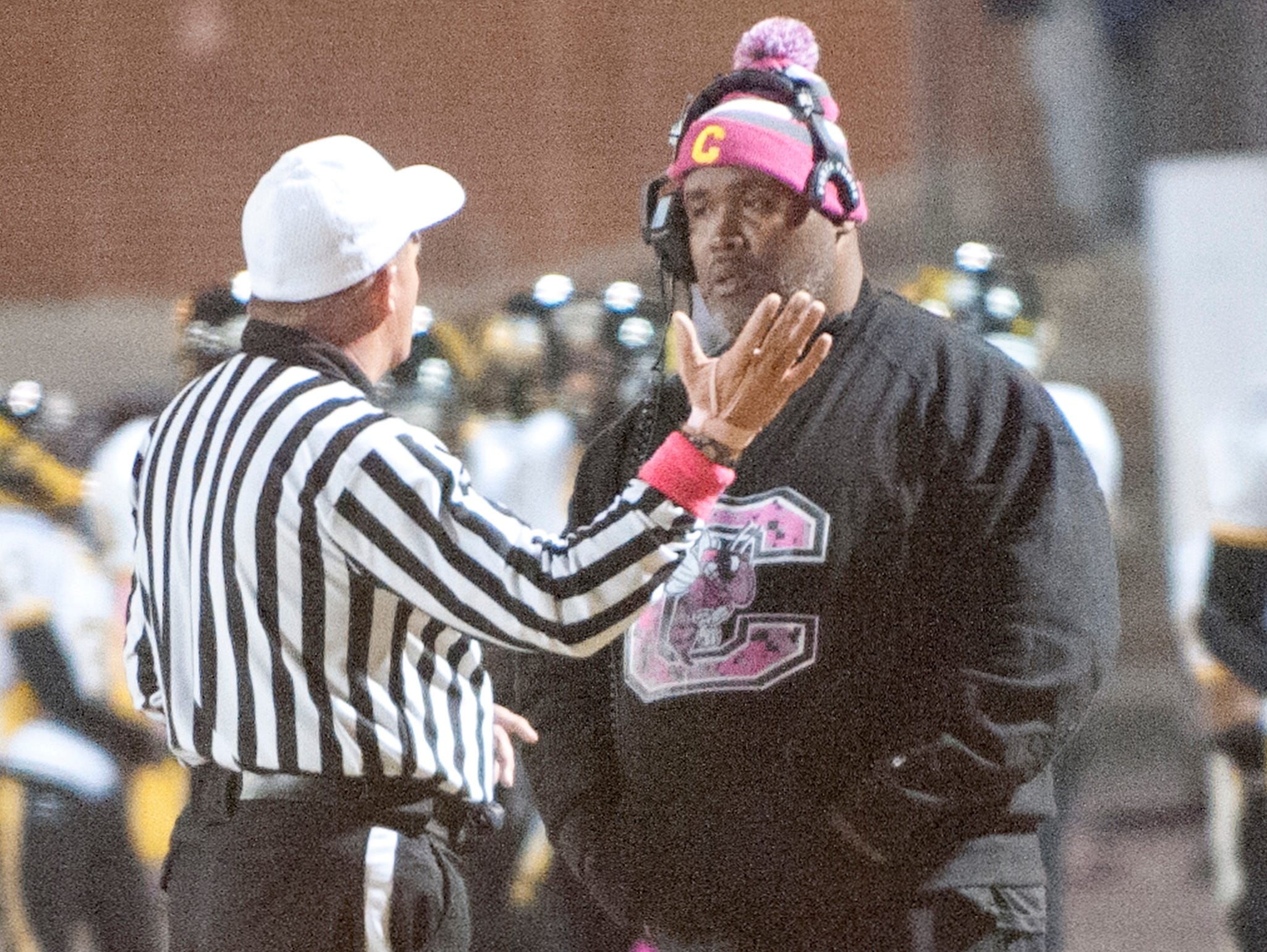 Central Yellowjackets head coach Tyrran Scroggins discusses a call with the referee. 30 Oct 2015