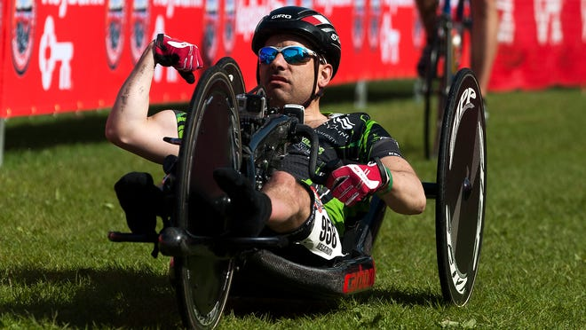 Handcyclist Jeremy Shortsleeve pumps his fist as he crosses the finish line first during the 26th Keybank Vermont City Marathon on Sunday in Burlington. He broke his own course record by 36 seconds.