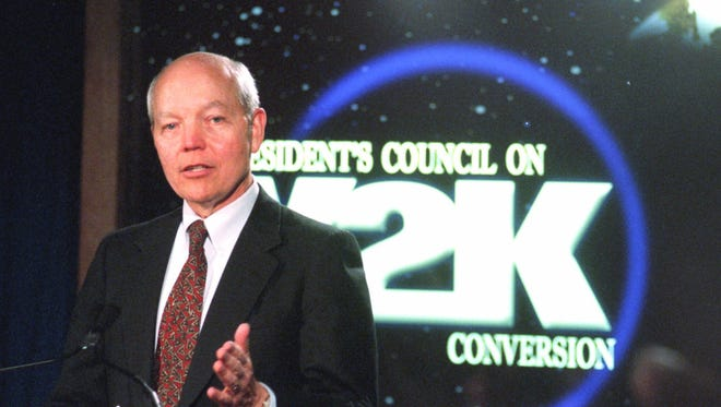 John Koskinen, the White House'a top Y2K adviser, briefs reporters on Dec. 27, 1999, at the President's Council on Year 2000 Conversion Coordination Center in Washington.