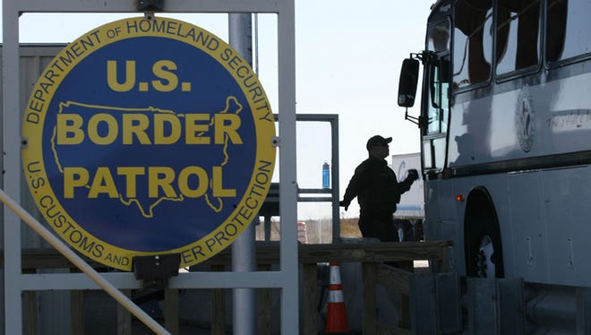 A U.S. Border Patrol agent checked a bus headed east at the Sierra Blanca checkpoint.