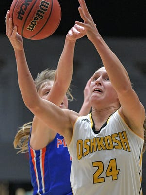 UW-Oshkosh's Eliza Campbell (24) goes up for a shot during Wednesday's win over UW-Platteville.