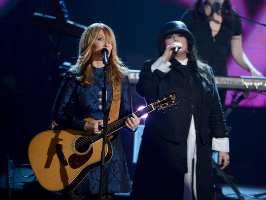 """Rock and Roll Hall of Fame sisters Nancy Wilson, left, and Ann Wilson of Heart break out the guitars and such classic hits as """"Crazy on You,"""" """"Magic Man"""" and """"Barracuda"""" for a sold-out show Sunday night at Fox Cities Performing Arts Center in Appleton. The concert benefits A Very Special Place, a Fox Valley daycare for children and adults with special needs."""