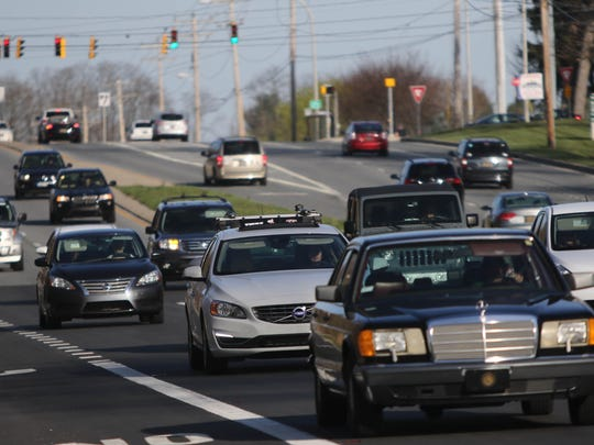 Vehicles move along Lancaster Pike at Centerville Road, near the former Delaware National Country Club, on March 30. A development plan for the site is the subject of a court case.