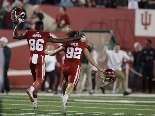 Indiana's Griffin Oakes (92) and Joseph Gedeon (86) celebrate after Oakes kicked a game-winning field goal during overtime of an NCAA college football game against Michigan State, Saturday, Oct. 1, 2016, in Bloomington, Ind. Indiana won 24-21. (AP Photo/Darron Cummings)