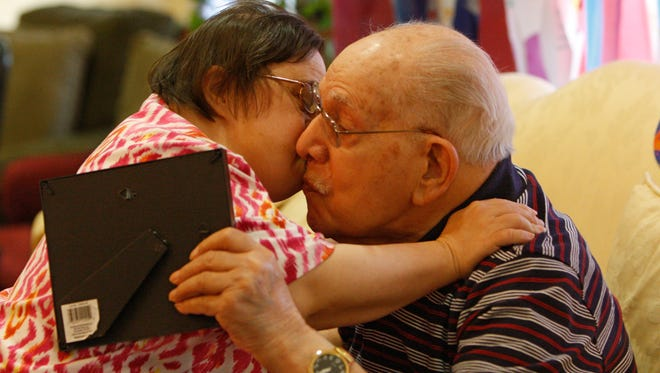 Pearl Harbor survivor Anthony Campanella kisses daughter Kathy Campanella at a  100th birthday celebration held for him Sunday at The Legacy at Cranberry Landing.