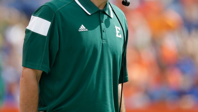Eastern Michigan head coach Chris Creighton shouts out to his players during the first half of an NCAA college football game against Florida in Gainesville, Fla., Saturday, Sept. 6, 2014.