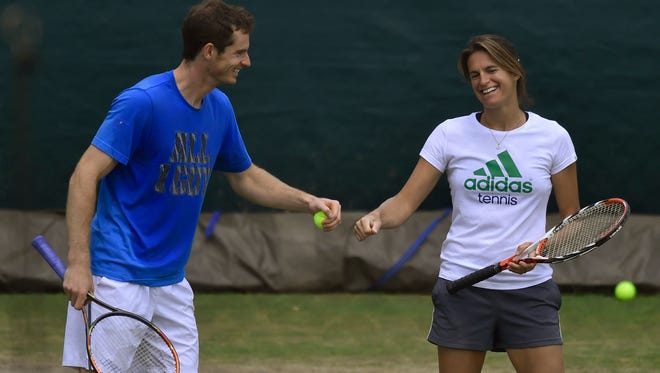 Andy Murray of Britain shares a moment with his coach Amelie Mauresmo as he practices at Wimbledon on Sunday.